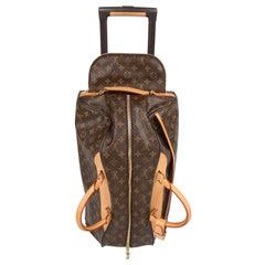 Louis Vuitton Monogram Canvas Eole 50 Rolling Duffle Bag - brown