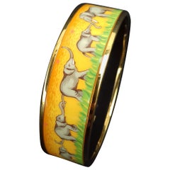 Hermès Enamel Printed Bracelet Elephants Grazing Gold Hdw Yellow Size GM 70