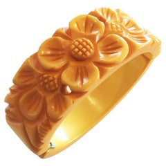 Art Deco Corn Yellow hinged carved bakelite flower clamper bracelet