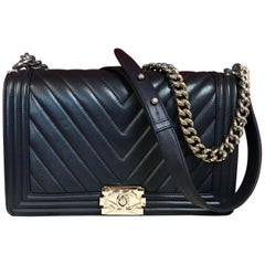 CHANEL Boy New Medium navy blue shoulder bag chevron lambskin 2016