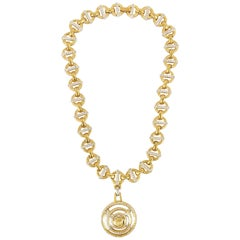 Gianni Versace 1990s gold circular necklace with medusa head pendant
