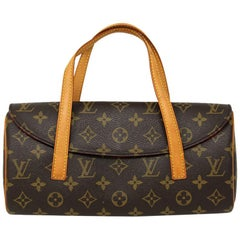 Authentische Louis Vuitton Sonatine Clutch mit Monogramm