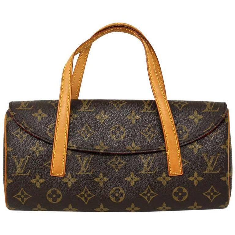 Authentic Louis Vuitton Sonatine Monogram Clutch Handbag For Sale