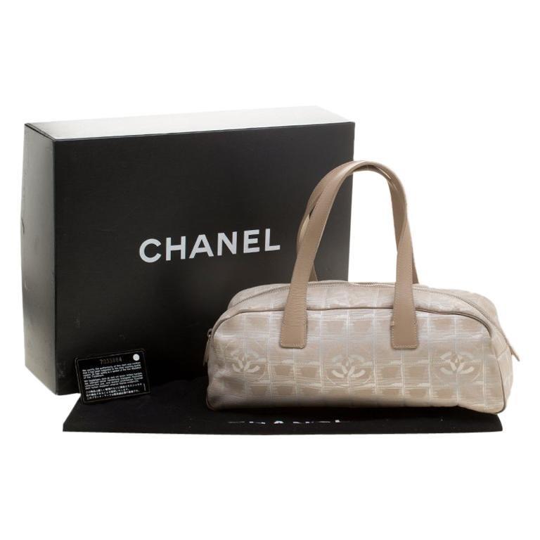 b20cf5e4c900f StartseiteModeHandtaschen und PortemonnaiesHenkeltaschen. Chanel Beiger  Canvas Travel Ligne Baguette-Tasche 1