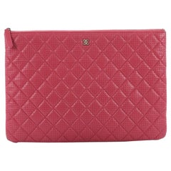 Chanel O Case Clutch Quilted Perforated Lambskin Large