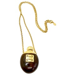 Givenchy 1977 vintage faux tortoiseshell perfume bottle necklace.