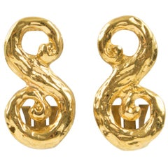 Yves Saint Laurent Paris Signed clip Earrings Gilt Metal S shape with texture