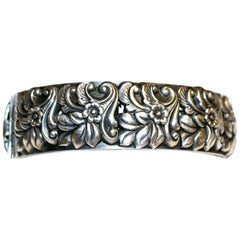 Circa 1950s Sterling Silver Floral Repoussé Hinged Bangle