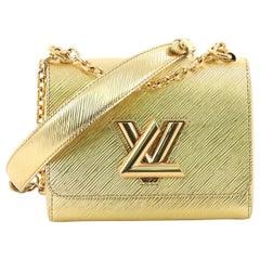 Louis Vuitton Twist Handbag Epi Leather PM