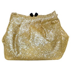 All That Glitters is Gold with Philip Treacy's New Gold Tone Glitter Clutch Bag