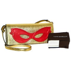 Brand New Elena Ghisellini Gold Tone Leather Clutch with Removable Red Mask
