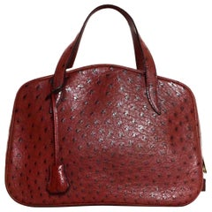 Hermes NEW Limited Edition Maroon Ostrich Doha Bag w/ Dust Bag, Lock & Key