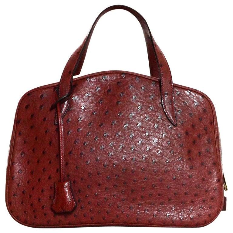 6dec2db7e39c Hermes NEW Limited Edition Maroon Ostrich Doha Bag w  Dust Bag