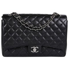 CHANEL Maxi Jumbo Double Flap Bag in Black Caviar Leather