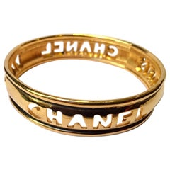 Chanel 1980s Gold Tone Cut Out Bangle