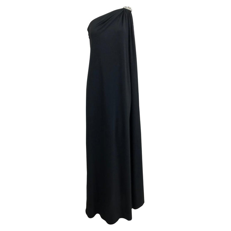 Adele Simpson black jersey one shoulder gown with jewel clasp For Sale