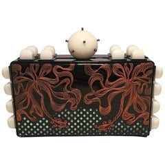 Tonya Hawkes Black Patent Leather Laser Cut and Etched Orange and Teal Clutch