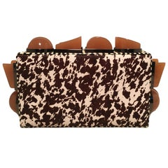 Tonya Hawkes Brown and White Cow Print Pony Hair Clutch with Tan Acrylic Studs