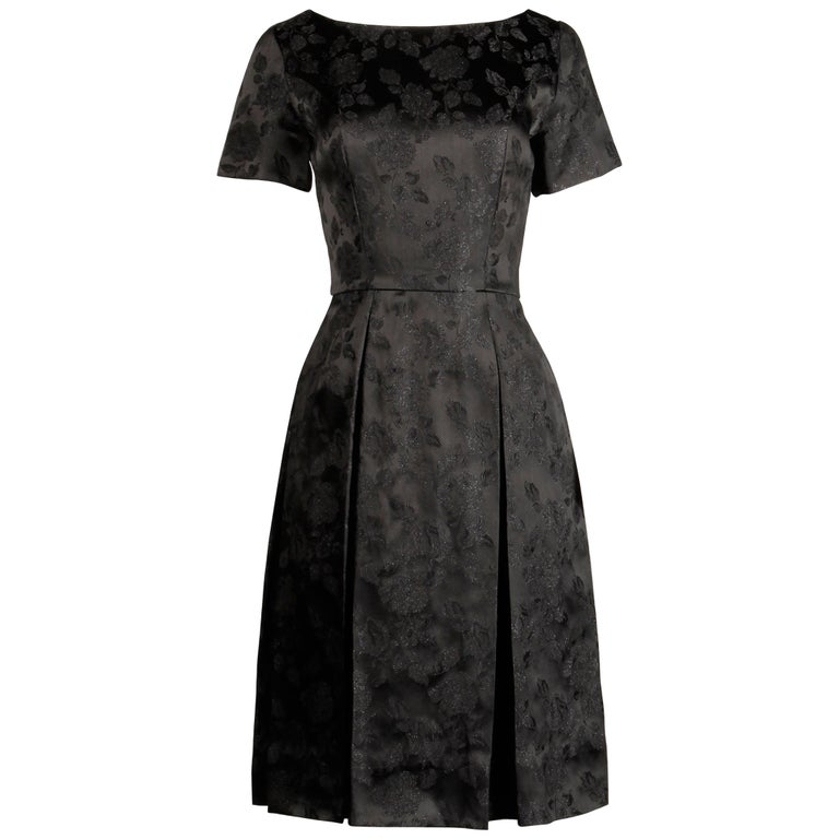 1960s Vintage Black Satin Floral Brocade Cocktail Dress with Box Pleats For Sale