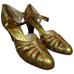 Pair of T-bar golden Salome shoes for the ball Circa 1930