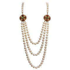 CHANEL 1984 Multi row beaded necklace with gilted metal Byzantine medallions