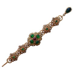 CHANEL 1980s articulated Byzantine gilded metal bracelet with rhinestones