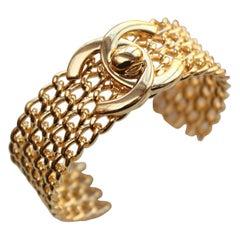 CHANEL 1996 P gilted metal twist lock cuff bracelet