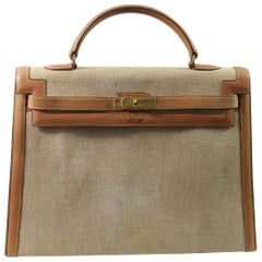 Viintage Hermes Kelly 35 in Brown Leather and Canvas. Fair condition