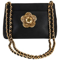 CHANEL Evening Bag in Black Satin with a Camellia in Gilt Metal