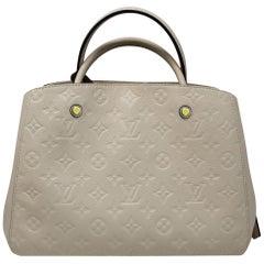 Louis Vuitton Montaigne Neige Empreinte Handbag With Dust Bag