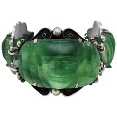 Circa 1930s Sterling Silver and Carved Green Onyx Mask Bracelet