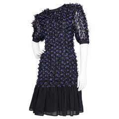 A Vintage Givenchy Black Cocktail Dress With Purple Bows