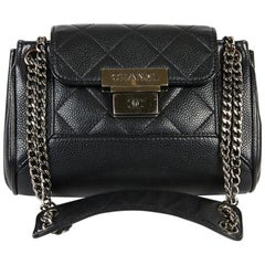 CHANEL Mini Flap Bag in Black Caviar Leather