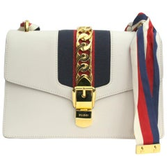 b8dd3c8194f Rare 1960s Gucci White Leather and Bamboo Purse at 1stdibs