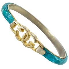 Gucci 1970s gold plated teal snakeskin leather bracelet.