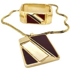 Lanvin 1970s Modernist enamel bangle bracelet and pendant set
