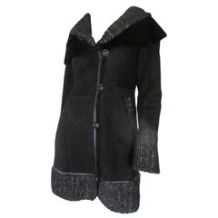 Black shearling fur coat with silver knitted details