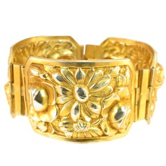 French Art Deco Gilded Floral Repousse Hinged Bracelet, 1920s