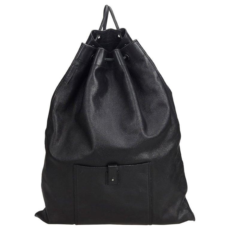 6b8659b362c7 Gucci Black Leather Drawstring Backpack at 1stdibs