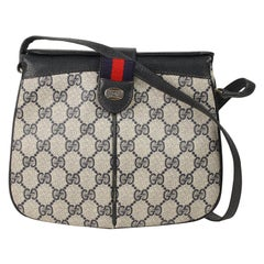 6dae521abe5 Gucci Vintage Blue Monogram Canvas Small Shoulder Bag with Stripes