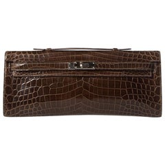 HERMÈS  Crocodile Kelly Cut Longue Clutch