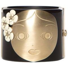CHANEL  Black & Gold-Tone Matryoshka Doll Cuff Bracelet