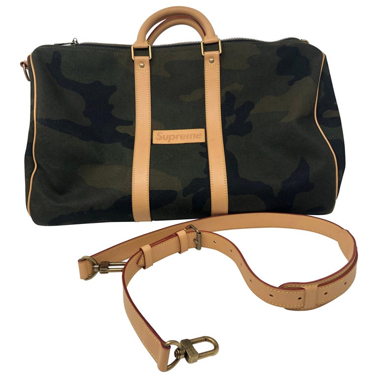 Louis Vuitton x Supreme camouflage Keepall 45, 21st century, offered by Agora Vintage