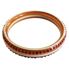 Art Deco red and cream celluloid bangle bracelet with rhinestones