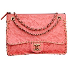 Chanel elegant bag in salmon pink leather with camellia pattern