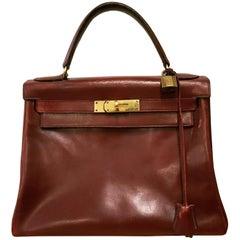Hermès vintage 1950's marron/ burgundy leather Kelly bag.