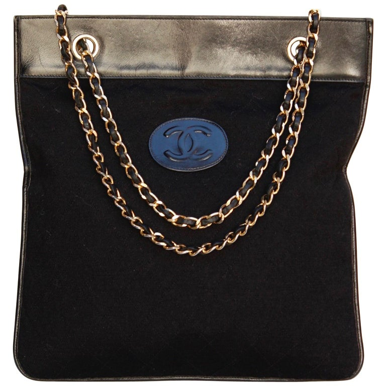6721f9b930073e Chanel black leather and jersey bag with chain handles, 1970's For Sale