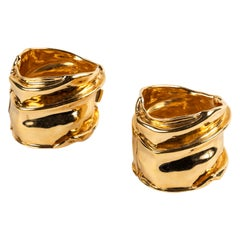 A Pair of Gold Tone Cuffs by Ciner