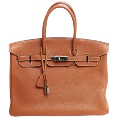 35 Hermes Birkin, brown with dust cover and silver hardware stamped K