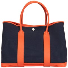 7b08a96683eb 2016 Hermès Orange Poppy Negonda Leather   Blue Marine Canvas Garden Party  36cm